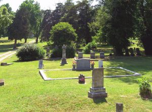 Headstones and grave markers in the cemetery.