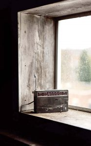 Image shows a portable radio in a window