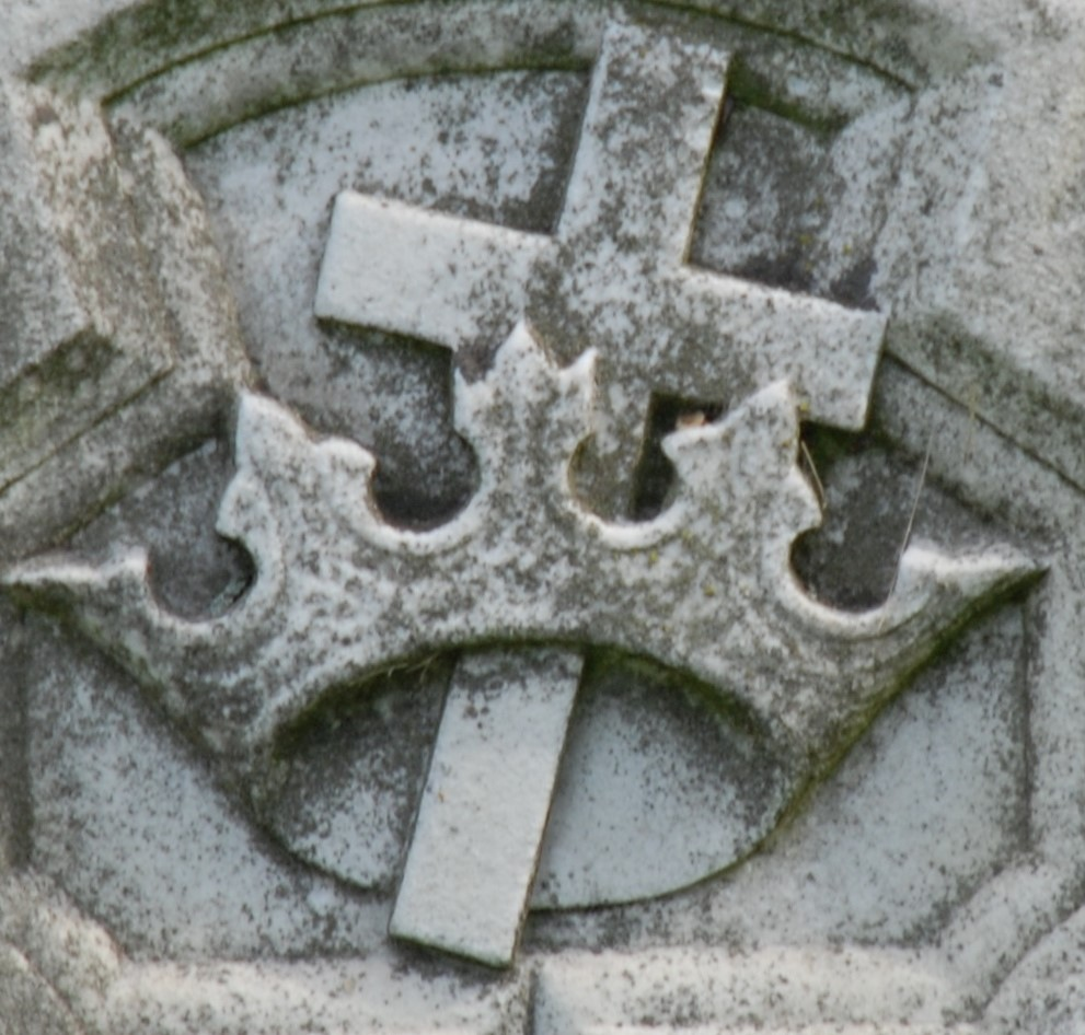 Cross and crown carved in marble.