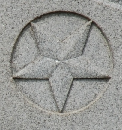 Five pointed star with point facing down.