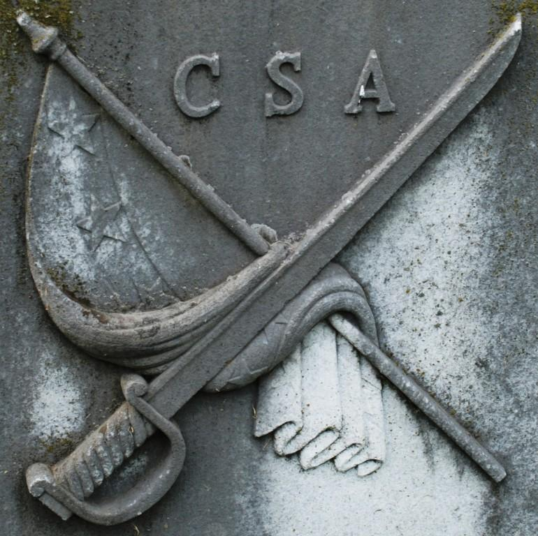 Sword and flag motif, CSA letters.