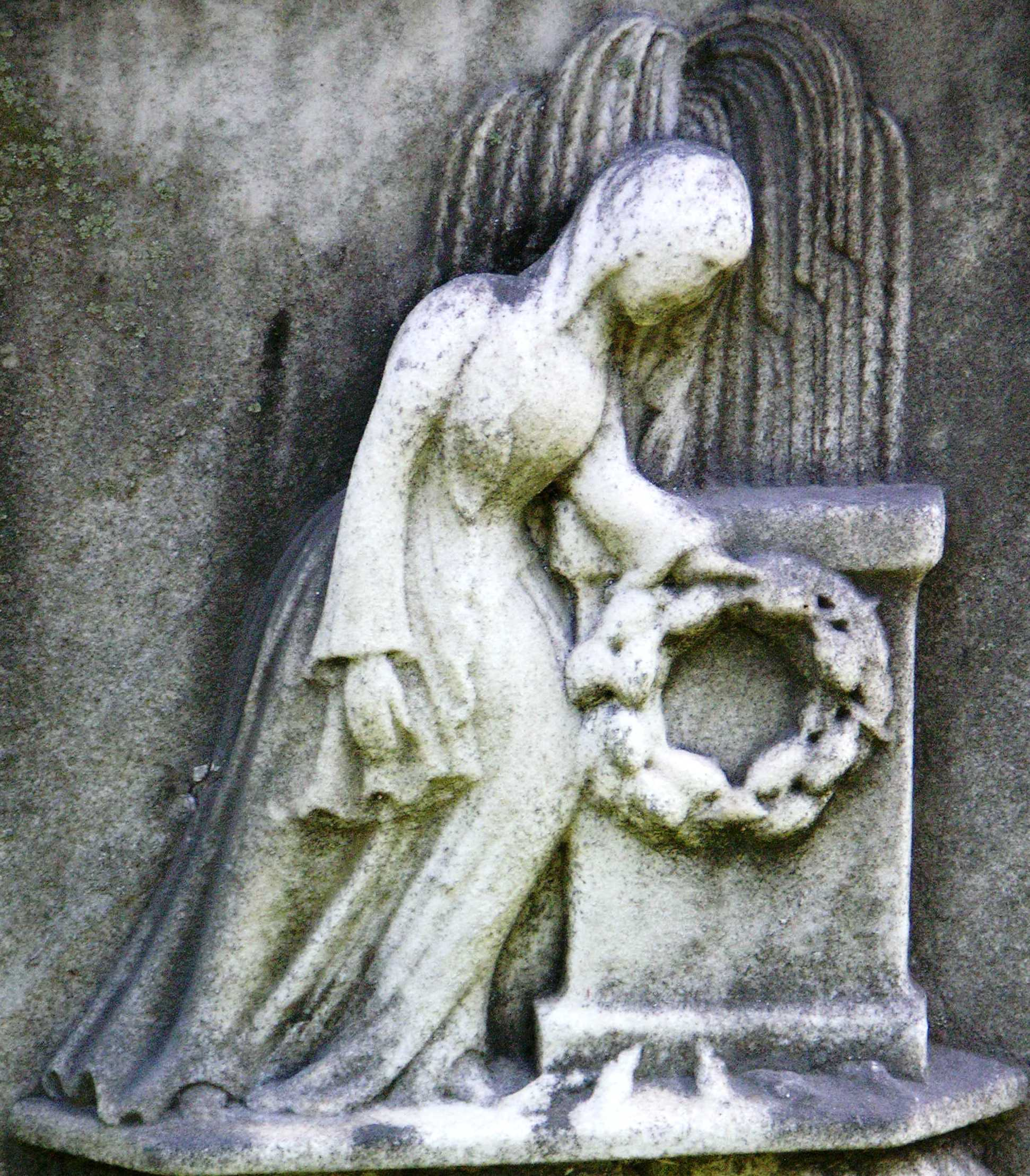 Figure of a woman mourning.