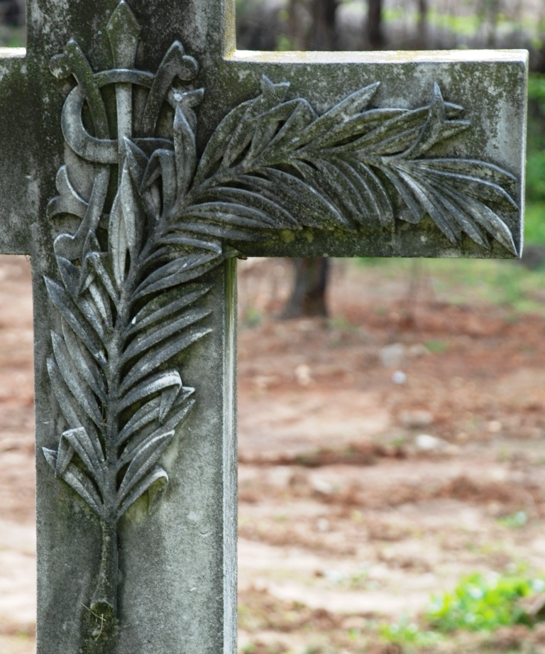 Palm on a cross with I.H.S.