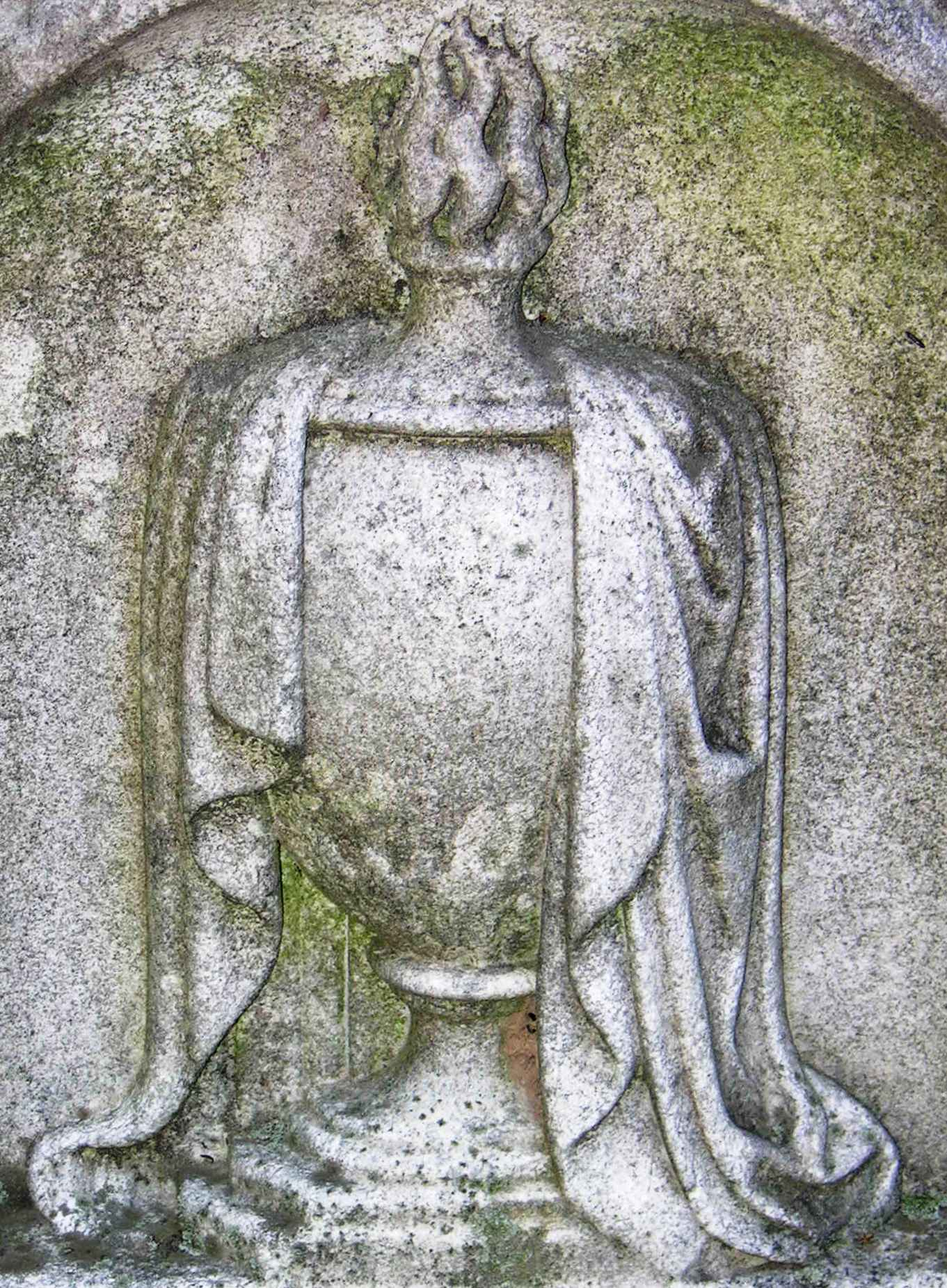Urn draped with cloth.