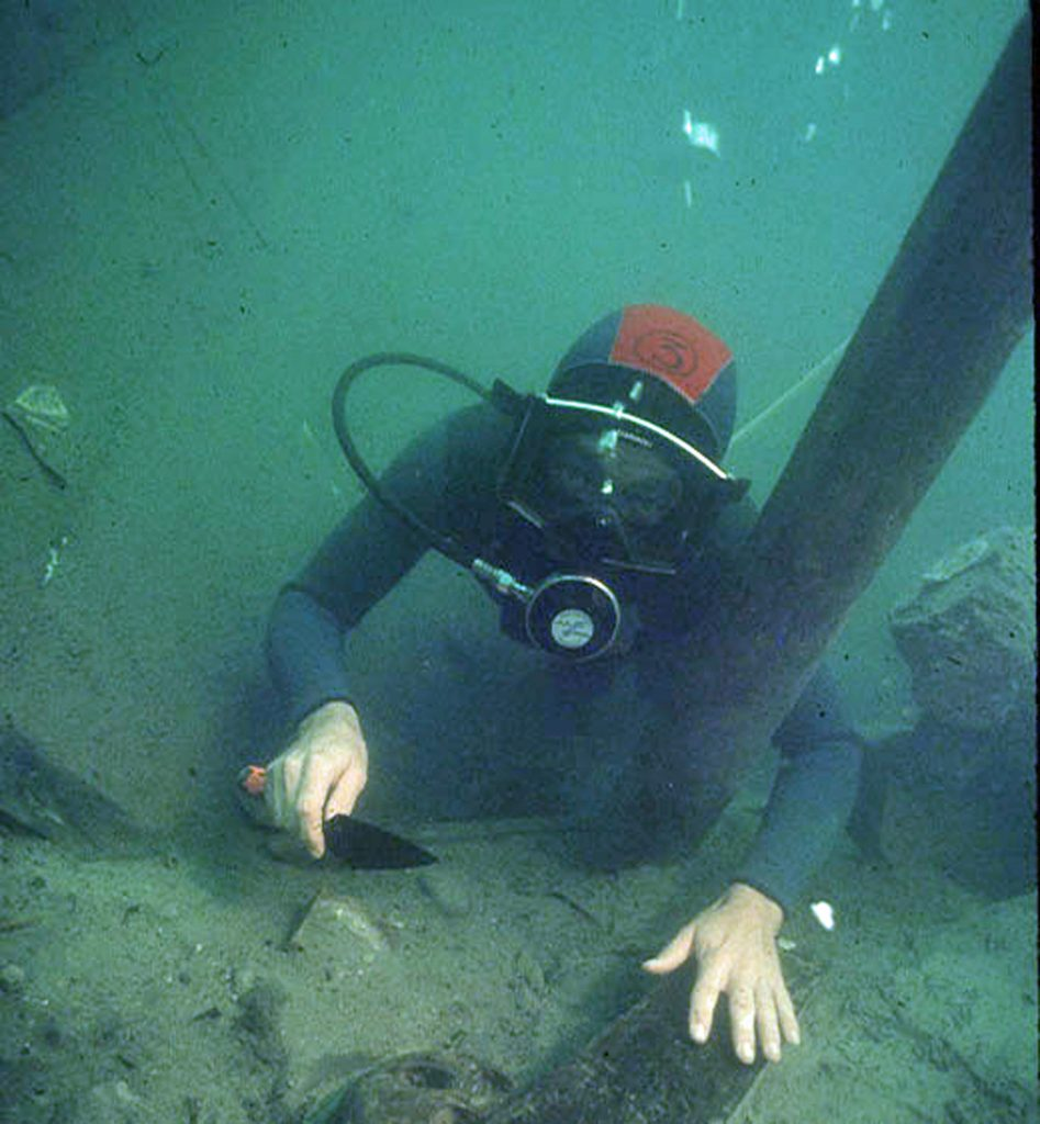 An archaeologist investigating the shipwreck The Betsy underwater.