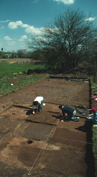 """Imposing a three-dimensional horizontal and vertical grid is the only way of establishing spatial control at an archaeological site. All points in a grid are related to a datum, a reference point of assigned horizontal and vertical location. Usually, archaeologists will designate this point with a metal pipe. After the datum point has been established, a physical grid is created over the area of examination with a surveyor's transit. The value of this system is that every point, within the boundaries of the grid, is known in relation to every other point and all artifacts can be recorded in spatial terms. Click on the """"Dig Deeper"""" to see more examples of archaeological sites and select the """"Try It!"""" icon to see if you can imagine what a building looked like from the archaeological footprint."""