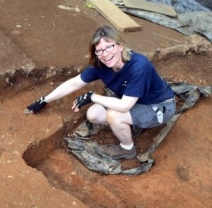 Laura Galke, DHR Chief Curator, working at an archaeological site.