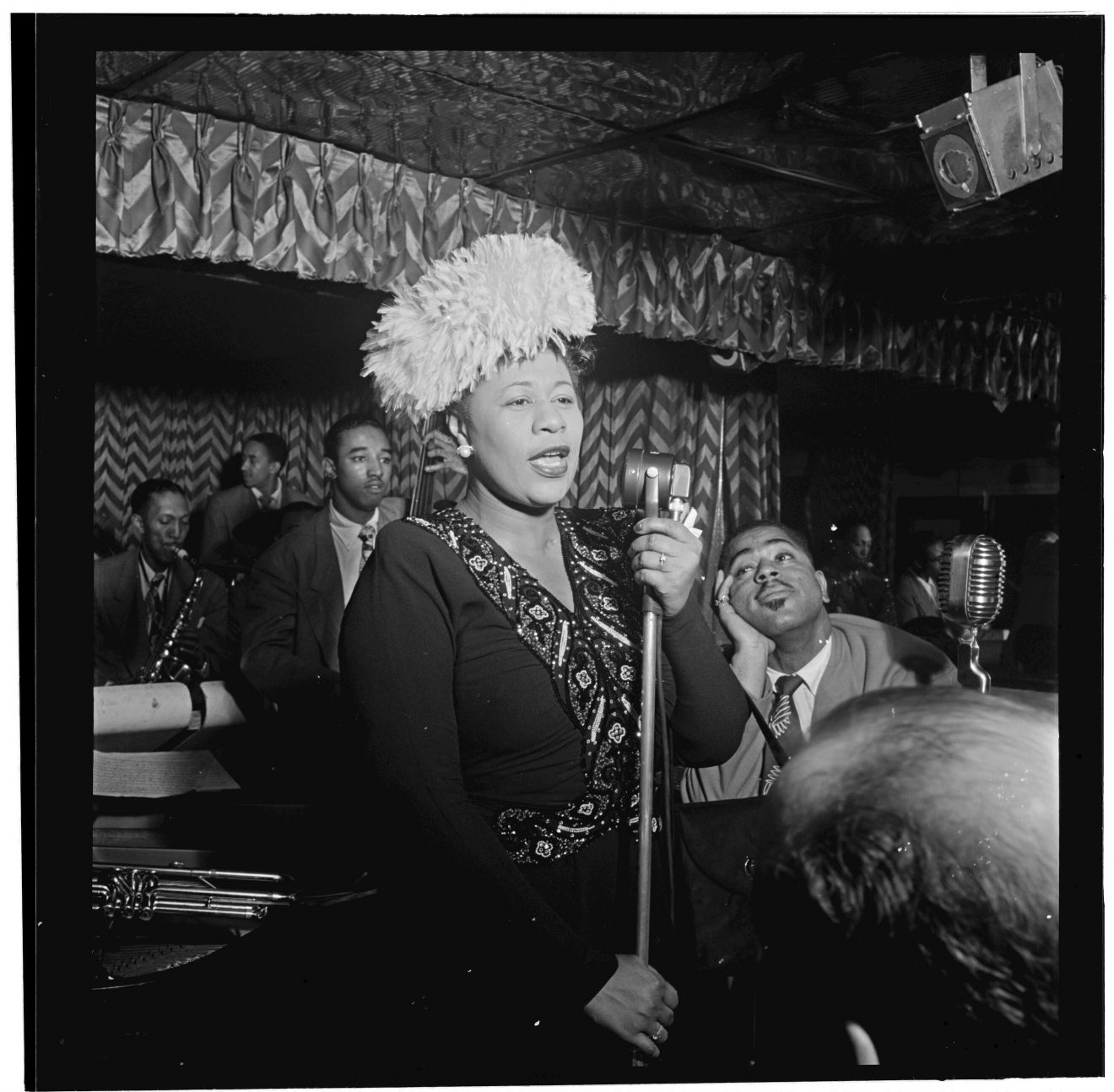 Ella Fitzgerald singing with band.