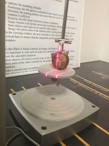 Conducting a 3-D scan of a wine bottle seal