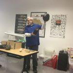 Dr. Broadwater holding a 3-D replica of an artifact