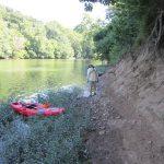 Archaeologist examines shoreline exposure.