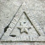 """SONS OF TEMPERANCE: organization with roots in the Temperance movement. Triangle with the words """"Love, Purity, Fidelity""""."""