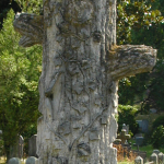 TREE STUMP: A life cut short in its prime. Some iconographers believe that the branches represent other deceased family members. Inclusion of ivy, lilies, and other plants represents faith in resurrection and eternal life.