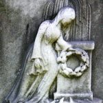 Mourning figures may also be combined with other funerary symbols, as in this tableau including a monument, wreath, and weeping willow.