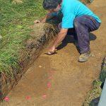 Excavating a grave shaft.
